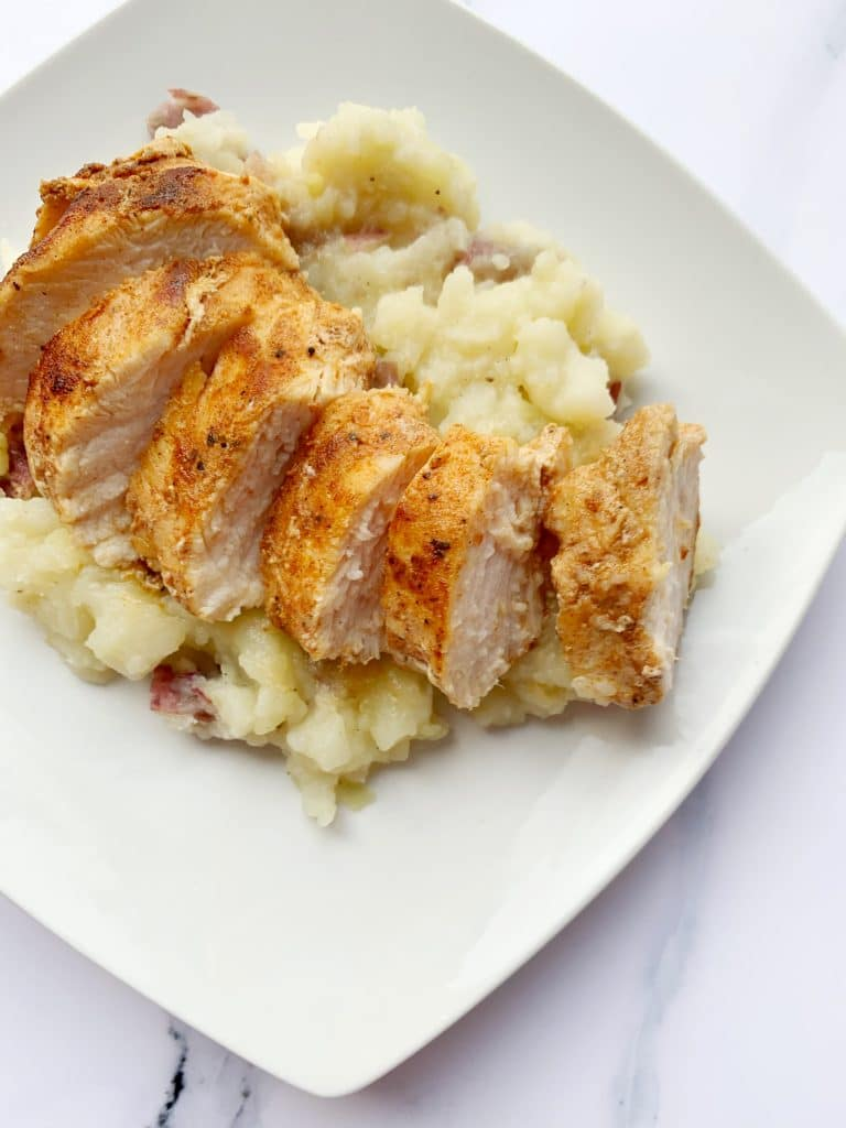 juicy jerk chicken over roasted mashed potatoes