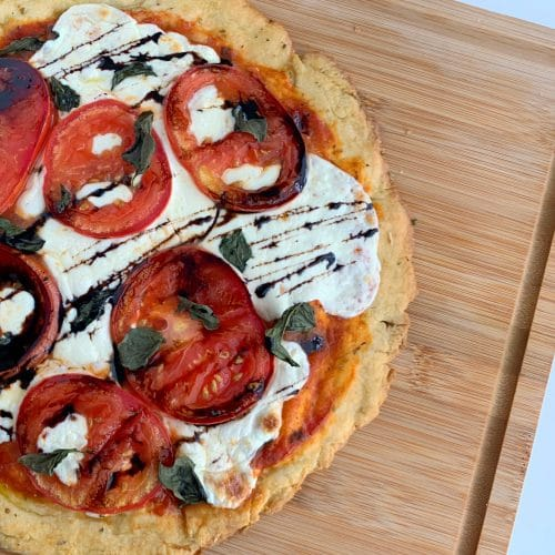 overhead shot of caprese pizza with balsamic glaze