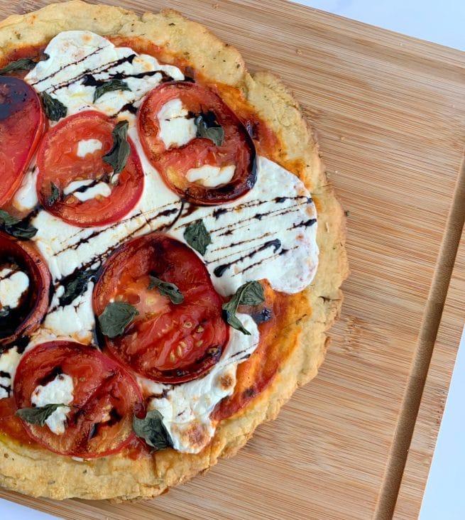 overhead shot of caprese pizza with balsamic glaze