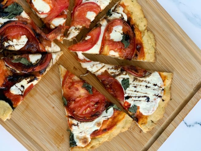 slices of caprese pizza with balsamic glaze