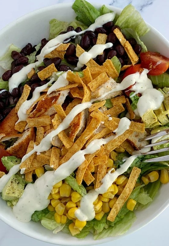overhead shot of southwest chicken salad with ranch drizzle