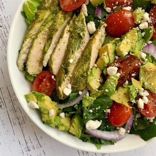 closeup of pesto chicken and avocado salad