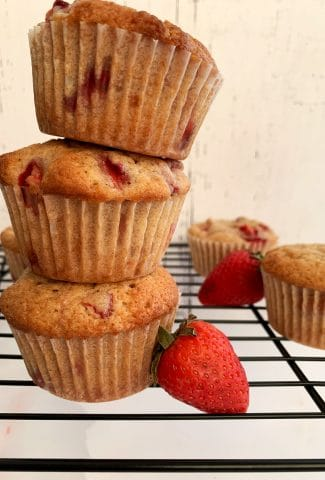 stack of strawberry muffins on a wire rack